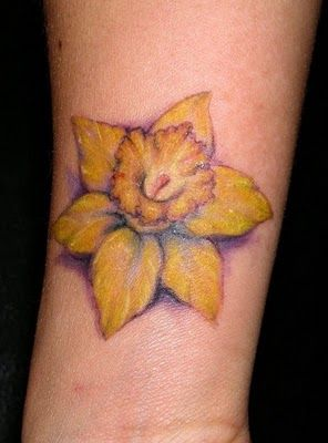 Yellow flower tattoo by Jessica Brennan