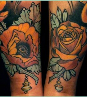 Yellow flowers tattoos by Lars Uwe Jensen
