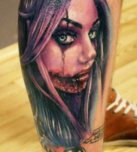 Young terrible santa muerte girl tattoo on leg
