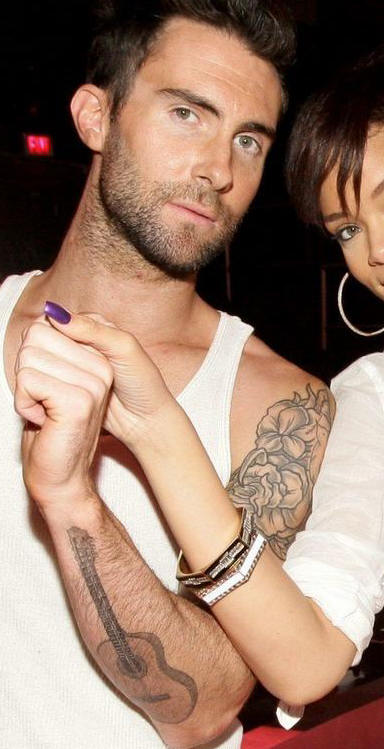Adam Levine Guitar Tattoo on Right Forearm