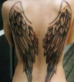 Angel Wing Tattoo On Woman's Back