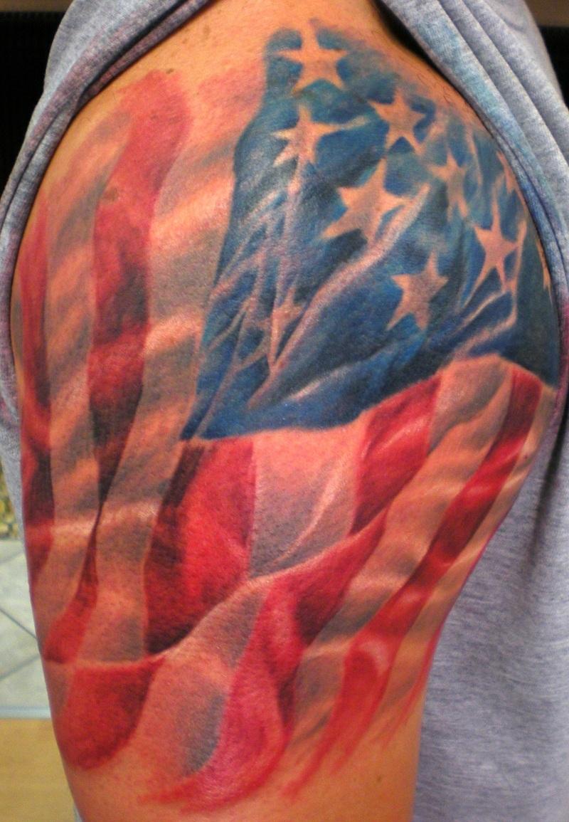 American Flag Draped Over Shoulder Tattoo Design