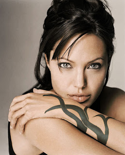 Angelina Jolie Left Hand Tattoo Removal Stories