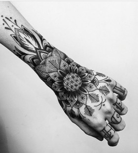 arm and hand flower tattoo