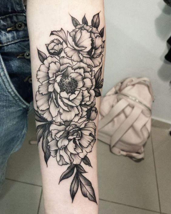 arm dotwork flower tattoo
