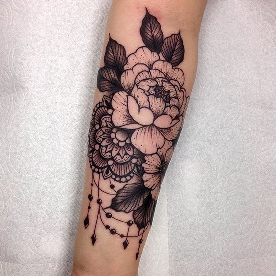 arm flower tattoo