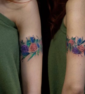 arm watercolor flower tattoo