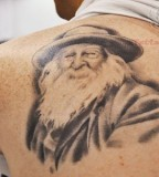 Back Shoulder Literary Tattoo For Men