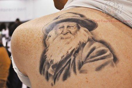 Back Shoulder Literary Tattoo For Men