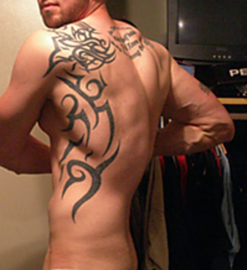 Athletic Body Man with Back Tribal Tattoos