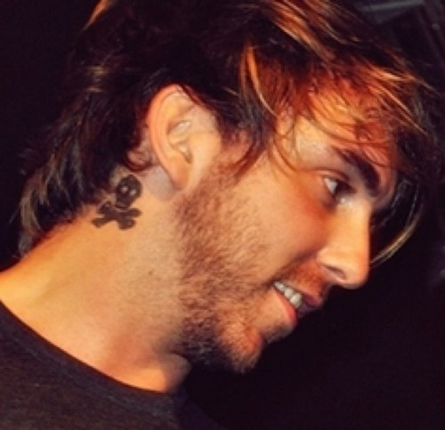 Skull Behind Alexs Ear Tattoo