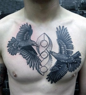 bird man chest tattoo