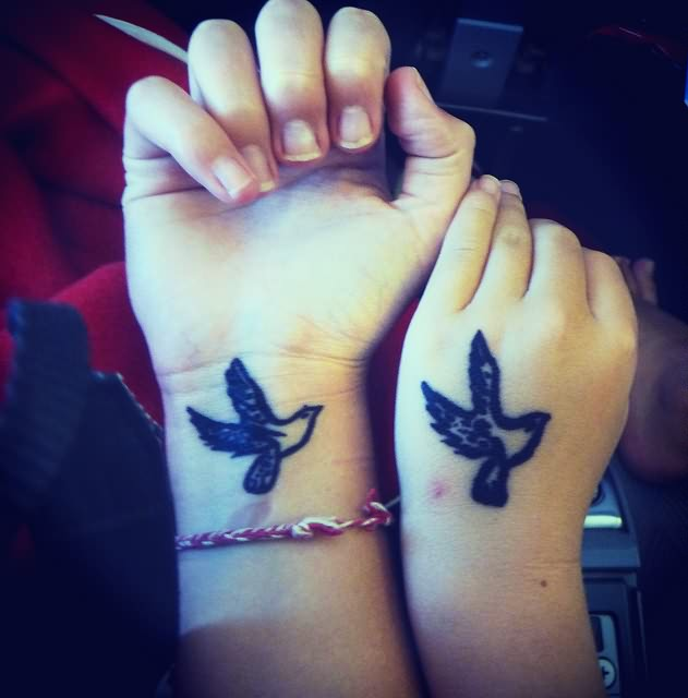 Lovely Duplicated Bird Tattoos On Hand And Wrist