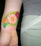 Cool Daisy in Green Bird Silhouette Tattoo