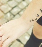 Awesome Five Flying Birds Silhouette Tattoo on Wrist