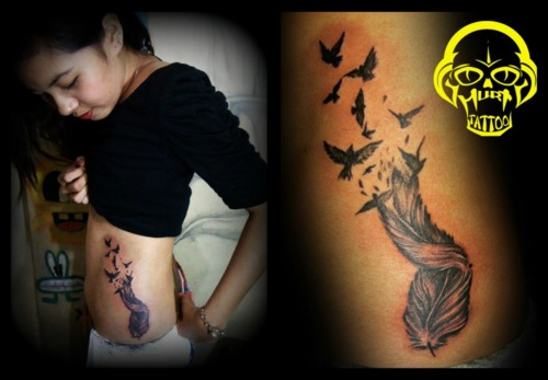 Feather Tattoo Design on Ribs for Women