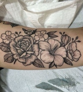 black and grey Hawaiian flower tattoo