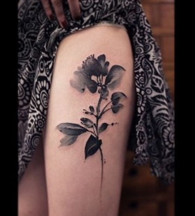 black and white watercolor flower tattoo