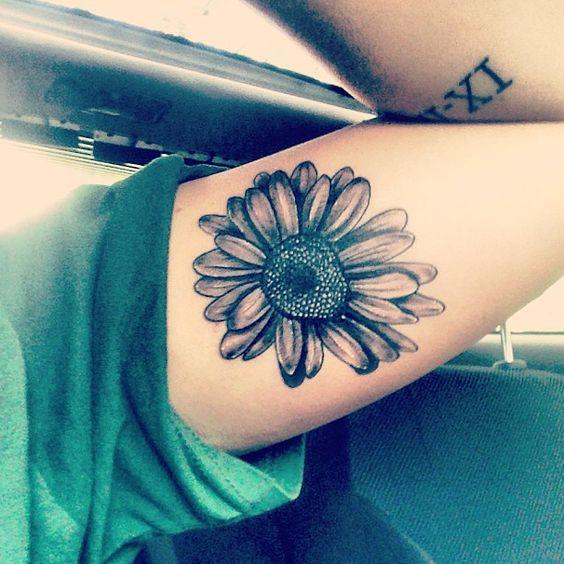 black daisy flower tattoo