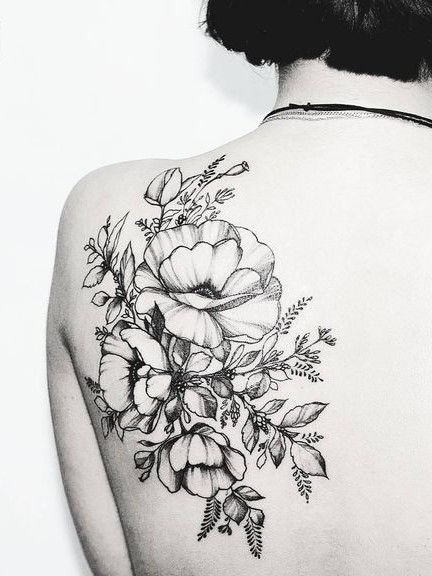black floral tattoo by Diana Severinenko