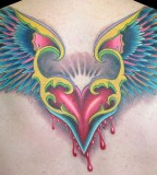 Color Tattoo Of A Flying Bleeding Heart The Wings