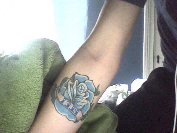 Cute Blue Rose Tattoo Design on Forearm