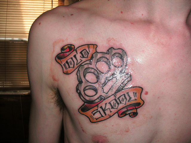 Brass Knuckles Tattoo on Chest