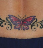 Butterfly And Tribal Tattoo On Lower Back