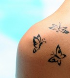 Three Cute Black Butterfly Tattoos on Shoulder