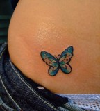 A Blue Butterfly Tatto on Hip
