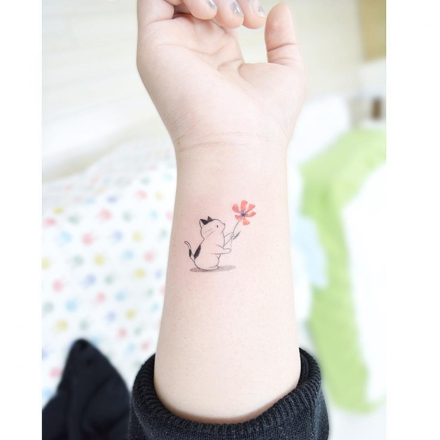 cat-holding-flower-tattoo-by-tattooist_banul