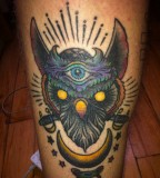 Head Of Totem Tattoo In Arm