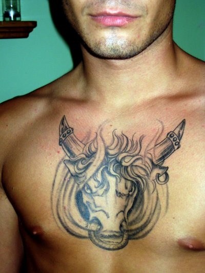Fiery Bull-Head Chest Piece Tattoo Design for Men