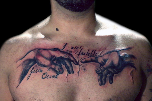 """Touching Hands"" Chest Tattoo Designs for Men"