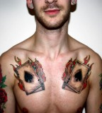 Firing Cards Chest Tattoo Inspiration for Guys