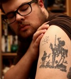 Cool Black Upper Arm Tattoo Design For Men
