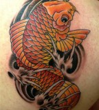 Red Koi Fish Tattoo On Back Shoulder