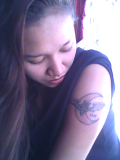 Bat And Crescent Moon Tattoo on Girl's Sleeve Angle View