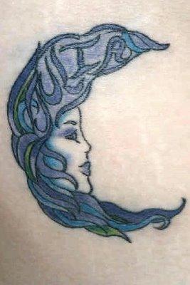 Women Face Crescent Moon Tattoo