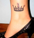 Crown Tattoos in Woman's Legs