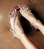 Cute Cross Tattoo On Ankle For Girls