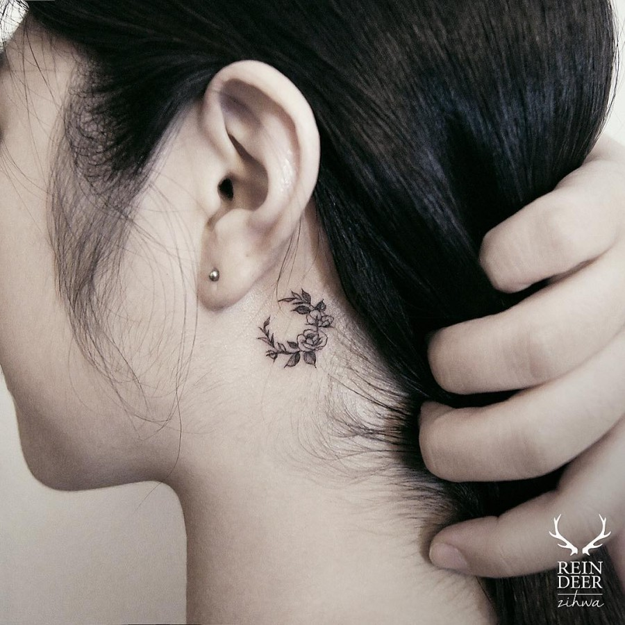 cute-behind-the-ear-flower-arrangement-tattoo