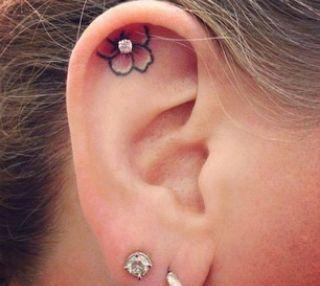 cute ear flower tattoo