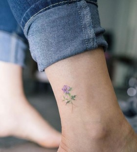 daintu blue flower tattoo