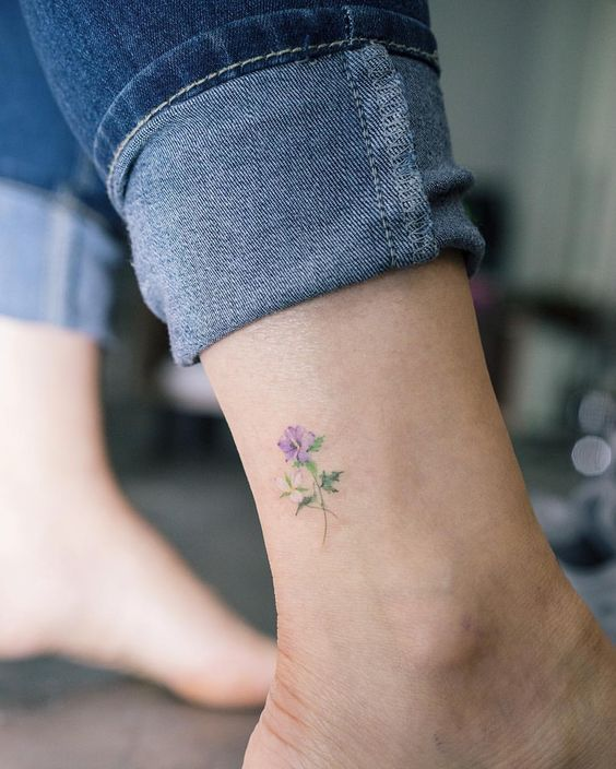 daintu blue flower tattoo