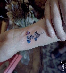 dainty-blue-flower-tattoo