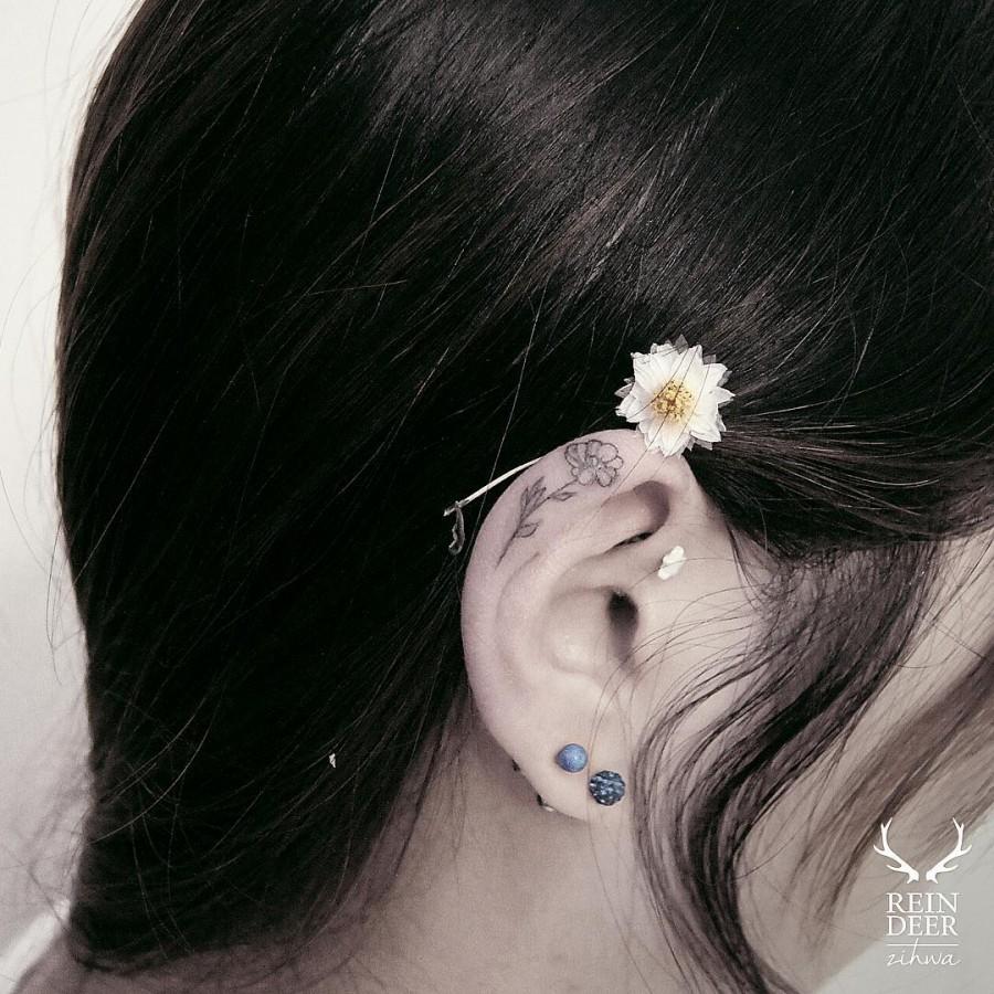 dainty-ear-flower-tattoo