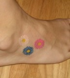 Colorful Daisy Flowers Foot-Tattoo Ideas for Women - Tattoos for Women