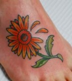 Lovely Daisy Foot-Tattoos Ideas for Women - Flower Tattoos for Women