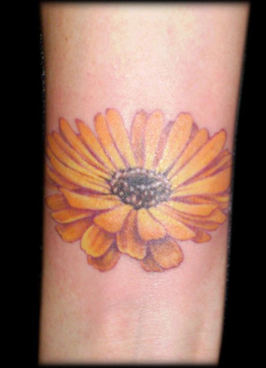Lovely Feminine Orange Daisy Flower Tattoo Design – Flower Tattoos